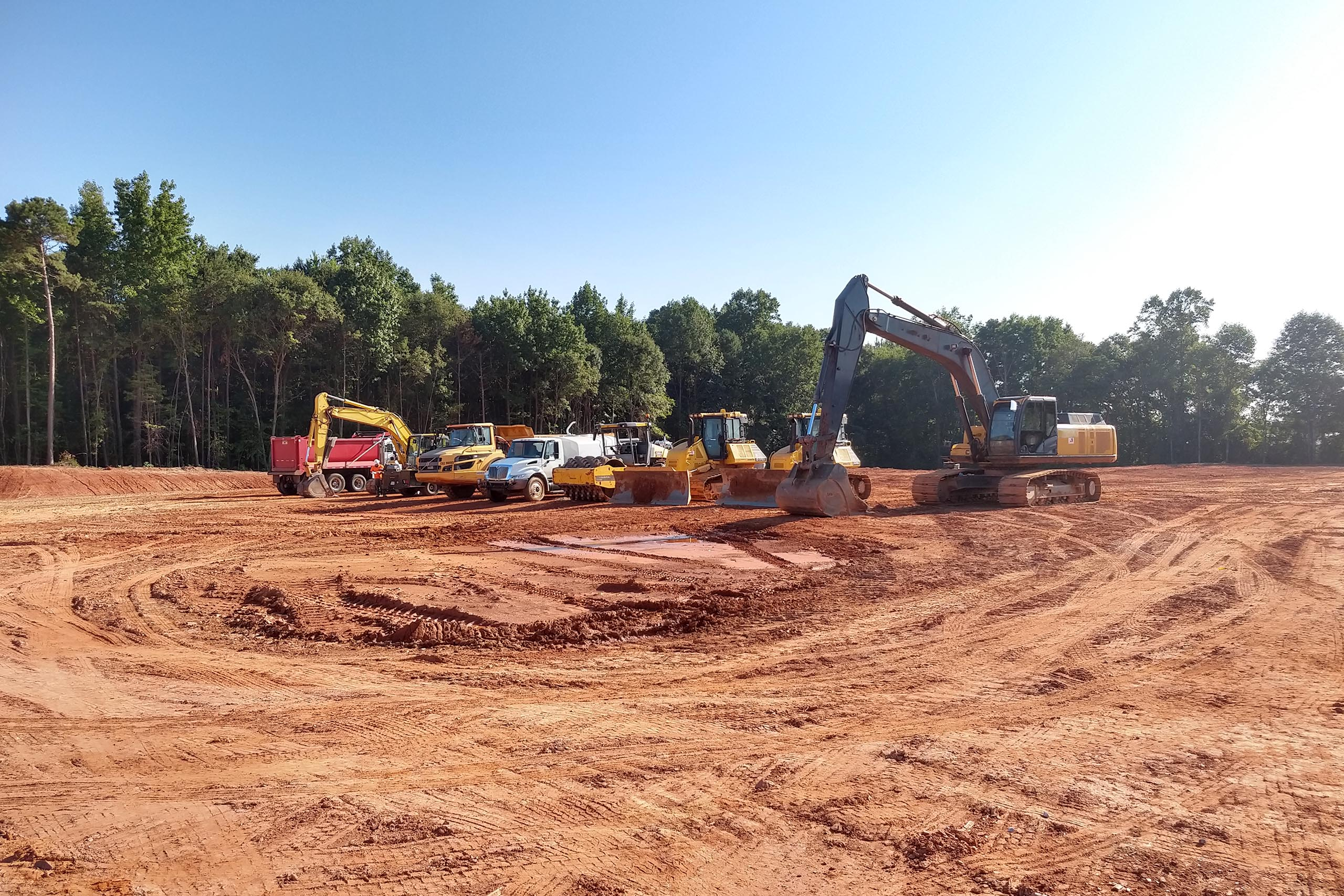 lineup of heavy equipment machinery and vehicles